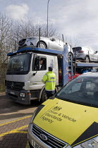 10-03-2015 - Trucks pulled over as part of the regular roadside checks by DVSA staff to ensure that HGVs are safe to drive on British roads. A vehicle inspector at a permanent check site off the M25 prepares to in... © Stefano Cagnoni
