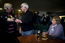19-12-2015 - Miners and families enjoying a drink and socialising. Protest by miners and supporters the day after Kellingley colliery closed down, West Yorkshire. © Connor Matheson