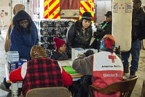 13-01-2016 - Flint, Michigan, Residents pick up clean bottled water and water filters from Red Cross disaster relief volunteers, Fire Station 6. Water and filters were distributed after cost cutting by state offic... © Jim West