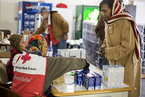 13-01-2016 - Flint, Michigan, Residents pick up clean bottled water and water filters from Red Cross disaster relief volunteers, Fire Station #6. Water and filters were distributed after cost cutting by state offi... © Jim West