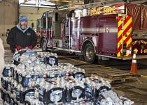 13-01-2016 - Flint, Michigan, clean Bottled water is delivered to Fire Station #6 for residents to collect. Water and water filters were distributed after cost-cutting by state officials led to high lead levels in... © Jim West