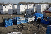 19-02-2016 - Official refugee camp of shipping containers. Refugees in the makeshift Jungle refugee camp, Calais, France. © Jess Hurd