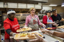 18-02-2016 - Flint, Michigan, Volunteers serving food, North End Soup Kitchen. The soup kitchen is operated by Catholic Charities © Jim West