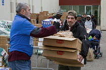 08-03-2016 - Detroit, Michigan, Volunteers at the Arab American and Chaldean Council distributing food to the hungry in its twice monthly Pantry of Plenty program © Jim West
