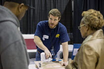 12-03-2016 - Flint, Michigan, Environmental Protection Agency worker explaining how to install a drinking water filter and giving residents information on the water crisis in the city. The Flint water supply becam... © Jim West