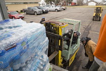12-03-2016 - Flint, Michigan, Christian volunteers distributing bottled water to residents. The citys water supply became unsafe after it was contaminated with lead © Jim West