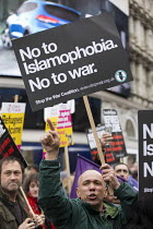 19-03-2016 - Stand Up to Racism National Demonstration, protesters opposing about 20 Britain First nationalists. Refugees Welcome, Stand Up to Racism, Islamaphobia, anti-Semitism and fascism. Central London. © Jess Hurd