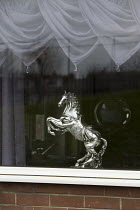 24-03-2016 - Rearing horse figurine ornament in a window, Easington Lane, Hetton, Tyne and Wear © John Harris