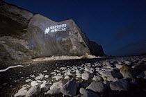 01-04-2016 - Refugees welcome projected across the white cliffs of Dover. Collaboration between campaign organisation Global Justice Now and guerrilla projectionists Feral X. © Jess Hurd