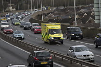 04-04-2016 - Ambulance responding to an emergancy speeding through M4 motorway traffic, Port Talbot, South Wales © John Harris