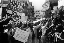 24-06-1968 - 1968 protest against the British Government's support for Nigeria through the continuing supply of arms during the Nigerian Civil War, London. Biafra blood on Britain's hands © Romano Cagnoni