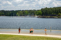 25-04-2016 - Pollards Corner, Georgia - Young men on the beach of J. Strom Thurmond Lake. The lake is created by the Thurmond Dam for hydropower, flood control and recreation. It is named after the late segregatio... © Jim West