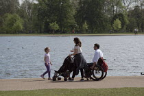 08-05-2016 - Family with a pushchair and wheelchair, Kensington Gardens, London © Philip Wolmuth