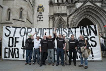 11-05-2016 - John McDonnell MP & Blacklist Support Group celebrating outside the Royal Courts of Justice after victory in their campaign for compensation for illegal blacklisting of construction workers © Philip Wolmuth