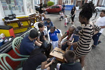 08-05-2016 - Street party at a corner shop, Coventry, playing draughts © John Harris