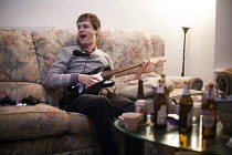 09-01-2016 - Young people playing a music video game Rock Band at home, Sheffield, Yorkshire © Connor Matheson