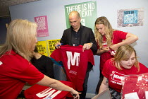 28-05-2016 - Yanis Varoufakis signing t-shirts at a Labour Party Momentum stand. Another Europe is Possible conference, Vote In campaign. UCL Institute of Education. London. © Jess Hurd