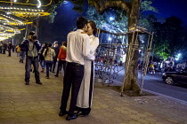 05-01-2016 - Hanoi, Vietnam A bride having her picture taken at night by Hoan Kiem Lake, a custom for women about to get married © David Bacon