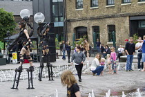 04-06-2016 - Punkx festival celebrating 40 years of punk, performance from the Mutoid Waste Company, Kings Cross, London. Stilt walkers © Jess Hurd