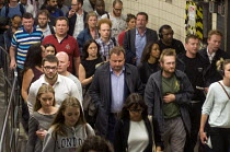 11-07-2016 - Tired commuters at the end of their working day walking from the underground platform to the exits at Victoria Station during the early evening 'rush-hour'. © Stefano Cagnoni