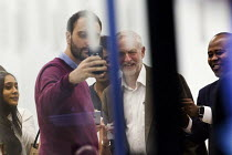 12-07-2016 - Security guard takes a selfie as Jeremy Corbyn leaves an NEC meeting after a vote that he is automatically on the ballot paper for the leadership challenge, Labour HQ, London. © Jess Hurd