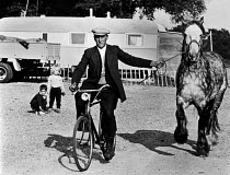 11-08-1962 - Permanent Gypsy site near Eton, Slough, early 1960s. Leading a horse by bycicle © Romano Cagnoni