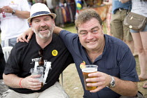 17-07-2016 - Mick Whelan ASLEF and Manuel Cortes TSSA enjoying a pint of beer, Tolpuddle Martyrs' Festival 2016. Dorset. © Jess Hurd