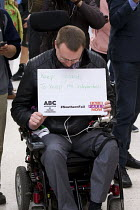 11-08-2016 - Disabled commuter campaigning for guards. Southern Rail passengers take a petition calling for fair fares and compensation to the Department of Transport, Westminster, Victoria Station London © Jess Hurd