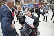 11-08-2016 - Disabled commuter campaigning for guards talking to Crispin Blunt MP. Southern Rail passengers take a petition calling for fair fares and compensation to the Department of Transport, Westminster, Lond... © Jess Hurd