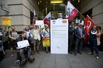 11-08-2016 - Southern Rail passengers take a petition calling for fair fares and compensation to the Department of Transport, Westminster, Victoria Station, London © Jess Hurd