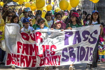 03-08-2016 - Sacramento, USA, Children of domestic workers protest for a permanent Domestic Workers Bill of Rights © David Bacon