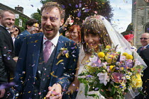 13-08-2016 - Hannah Edwards and Kieran Durkan getting married, being showered with confetti as they leave the church, Yorkshire © John Harris