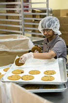 30-06-2016 - Las Vegas, Nevada, disabled baking cookies for sale in the Cookie Crafter program, nonprofit Opportunity Village © Jim West