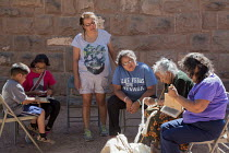 10-07-2016 - Ganado, Arizona, Navajo Nation, Woman using a Navajo spindle to spin wool into yarn. Wool and Weaving Workshop, Hubbell Trading Post National Historic Site © Jim West