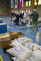 30-07-2016 - Detroit, Michigan, Volunteers prepare packages of food for hungry children. The packages include rice, soy, dehydrated vegetables, and vitamins. They are distributed by Kids Against Hunger in Detroit... © Jim West