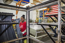 26-08-2016 - Sterling Heights, Michigan, worker stacking car components at a Servo Tandem stamping press, Sterling Stamping Plant, Fiat Chrysler Automobiles © Jim West