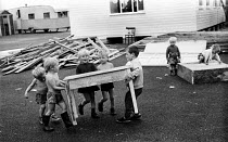 18-08-1969 - Traveller children families constructing a school 1969 for themselves on their site, on the outskirts of London, 1969. © Thurston Hopkins