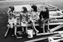 18-08-1969 - Traveller children sitting on a wooden frame 1969 for a school to be built for them on their site on the outskirts of London © Thurston Hopkins