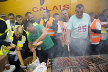 05-09-2016 - Blockade of truckers and farmers demanding Calais Jungle refugee camp closure joined by Port of Calais dockers with motorway barbecue, France. © Jess Hurd