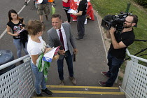 07-09-2016 - TV journalist interviews a Sports Direct worker Shirebrook, Derbyshire © John Harris