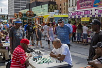 04-09-2016 - Detroit, Michigan, Men playing chess on the street during the Detroit Jazz Festival © Jim West