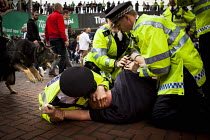 29-05-2016 - Police arresting a Millwall fan for fighting after league One victory over Millwall by Barnsley. Wembley Stadium, London © Connor Matheson