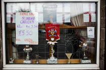 17-06-2016 - Pub window with nationalist pride, football and snooker trophies Barnsley, South Yorkshire. Sunday Carvery, The Dove Inn © Connor Matheson