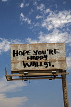 30-06-2016 - Las Vegas, Nevada - An anti-Wall Street graffiti billboard. © Jim West