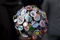 02-10-2016 - Anti austerity Protest, Tories Out, Austerity has Failed, Victoria Square, Birmingham. Hat full of campaign badges © John Harris