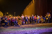 08-10-2016 - Nogales, Arizona, Religious activists hold a candlelight vigil at the USA Mexican border fence. The interfaith religious ceremony protested at the increasing militarization of the border, the separati... © Jim West