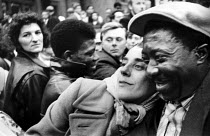 07-02-1965 - Black and white couple hugging in the street London 1965 © Malcolm Aird