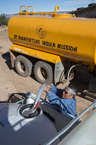 11-10-2016 - Thoreau, New Mexico, clean water being delivered by St. Bonaventure Indian Mission for a Navajo family. A third of the Navajo Nation lack a water supply in some places because past uranium mining has... © Jim West