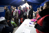 25-10-2016 - Refugees in the makeshift Jungle camp queue to be transfered to reception centres across France prior to a demolition planned by French authorities. Calais, France. © Jess Hurd