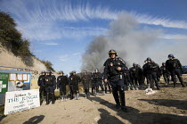 26-10-2016 - CRS police close the entrance, eviction of refugees from the Jungle camp, Calais, France © Jess Hurd